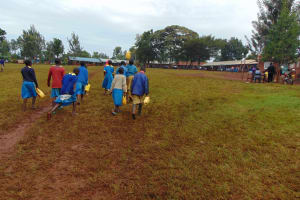 The Water Project: Kitagwa Primary School -  Carrying Water To The Kitchen