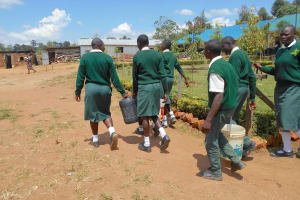 The Water Project: Friends School Manguliro Secondary -  Students Carrying Water