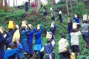 The Water Project: Kapsegeli KAG Primary School -  Students Begin The Trek Back To School