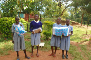 The Water Project: St. Martin's Primary School -  Girls Unpack Government Provided Sanitary Towels