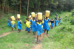 The Water Project: Isikhi Primary School -  Pupils Carrying Water Back To School