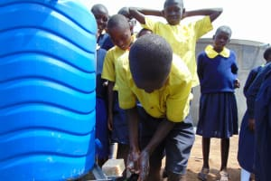 The Water Project: Kosiage Primary School -  A Pupil Practices Handwashing