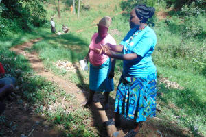 The Water Project: Bumira Community, Imbwaga Spring -  Karen Demonstrates Handwashing
