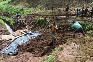 The Water Project: Busichula Community, Marko Spring -  Adding Soil Over The Tarp