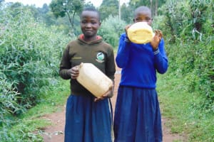 The Water Project: Kapsegeli KAG Primary School -  Students Carrying Water