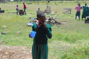 The Water Project: Ebukhayi Primary School -  Student Demonstrates Toothbrushing