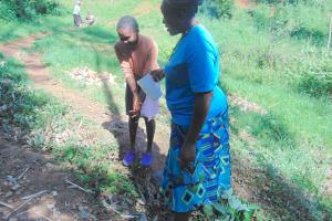 The Water Project: Bumira Community, Imbwaga Spring -  Handwashing Demonstration