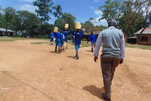 The Water Project: Jamulongoji Primary School -  Students Carrying Water