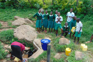 The Water Project: Galona Primary School -  Waiting For A Community Member To Fetch Water