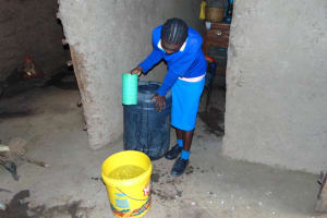 The Water Project: St. Joakim Buyangu Primary School -  Pupil Collects Water At Home
