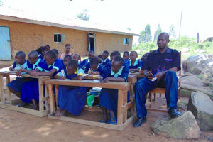 The Water Project: Mukama Primary School -  Participants Taking Notes