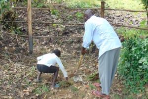 The Water Project: Buyangu Community, Mukhola Spring -  Grass Planting