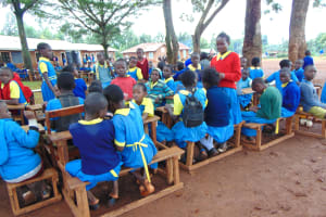 The Water Project: Kitagwa Primary School -  Pupils Wait For Closing Ceremony