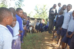 The Water Project: St. Martin's Primary School -  Boys Queueing To Use Latrines