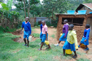 The Water Project: St. Joakim Buyangu Primary School -  Pupils Carrying Water To School