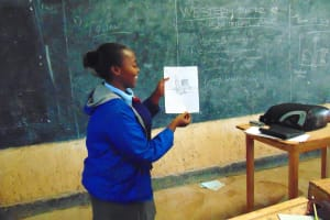 The Water Project: Banja Secondary School -  Pupil Shanice Shows A Poster