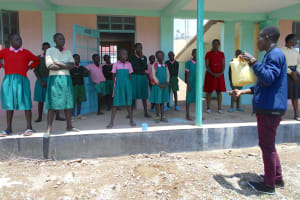 The Water Project: Ebukhayi Primary School -  Trainer Ian Shows A Tippy Tap For Handwashing