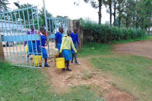 The Water Project: St. Joakim Buyangu Primary School -  Pupils Arrive At School With Water