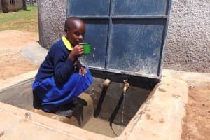 The Water Project: Kosiage Primary School -  Enjoying A Fresh Drink From The Rain Tank
