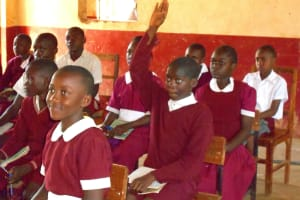 The Water Project: Ebukhuliti Primary School -  A Student Raises His Hand
