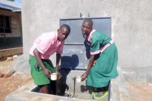 The Water Project: Mwichina Primary School -  Students Getting A Fresh Drink From The Rain Tank
