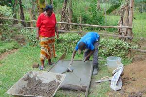 The Water Project: Buyangu Community, Mukhola Spring -  Finishing Touches To Slab