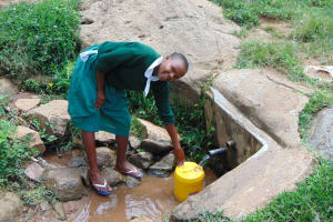 The Water Project: Galona Primary School -  Catherine Fetching Water
