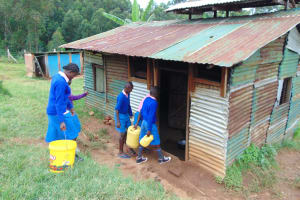 The Water Project: St. Joakim Buyangu Primary School -  Pupils Deliver Water To