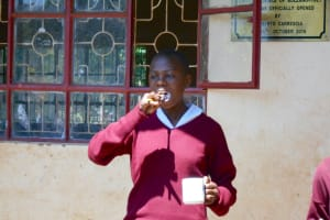The Water Project: Ebukhuliti Primary School -  Student Demonstrates Toothbrushing
