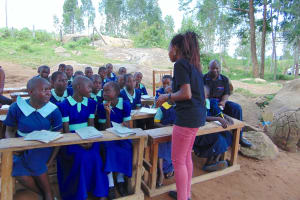 The Water Project: Mukama Primary School -  Students Confer Before Responding To Trainer