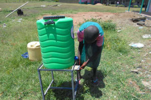 The Water Project: Ebukhayi Primary School -  Pupil Uses A Handwashing Station
