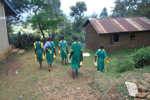 The Water Project: St. Peters Bwanga Primary School -  Students Carrying Water