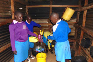 The Water Project: St. Joakim Buyangu Primary School -  Pupils Combine Water In Kitchen