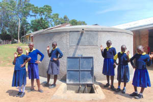 The Water Project: Kosiage Primary School -  Girls Pose With The Rain Tank