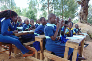 The Water Project: Mukama Primary School -  Student Imitate Toothbrushing