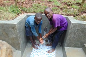 The Water Project: Kisasi Community, Edward Sabwa Spring -  Enjoying The Spring Water