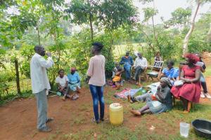 The Water Project: Shikhombero Community, Atondola Spring -  Man Demosntrates Toothbrushing