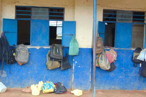 The Water Project: Kapsegeli KAG Primary School -  Pupils Bags Hang Outside A Classroom