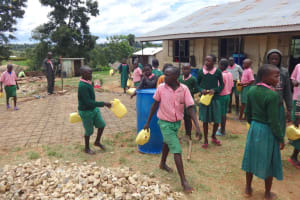 The Water Project: Mwichina Primary School -  Students Deliver Water For Construction