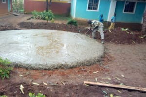 The Water Project: St. Joseph's Lusumu Primary School -  Fitting Tap And Drainage Pipes In Concrete