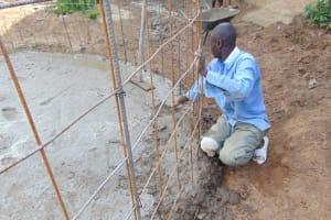 The Water Project: Mukama Primary School -  Setting Rebar Rain Tank Skeleton