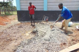 The Water Project: Ebukhayi Primary School -  Mixing Concrete Tank Foundation