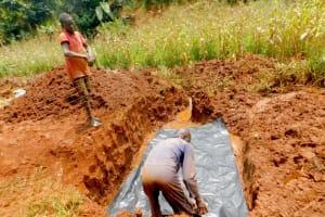 The Water Project: Shikhombero Community, Atondola Spring -  Laying The Foundation