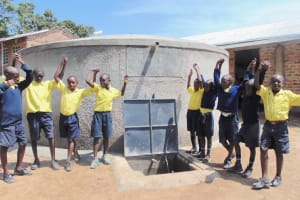 The Water Project: Kosiage Primary School -  Boys Pose With The Rain Tank