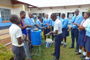 The Water Project: Kamimei Secondary School -  Student Leads Handwashing Practice