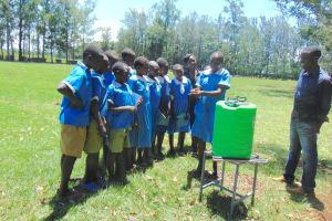 The Water Project: St. Joseph's Lusumu Primary School -  Pupil Demonstrates Handwashing