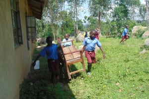 The Water Project: Kipchorwa Primary School -  Pupils Bring Benches For Training