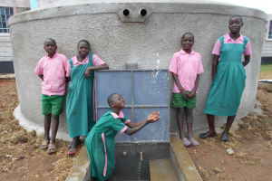 The Water Project: Ebukhayi Primary School -  Clean Water Flows From The Rain Tank
