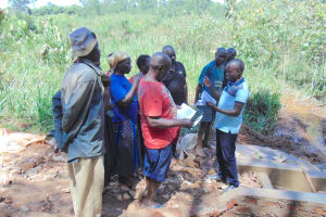 The Water Project: Jivovoli Community, Magumba Spring -  Training Continues At Spring Under Construction