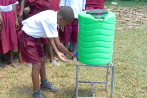 The Water Project: Ebukhuliti Primary School -  A Student Washes His Hands